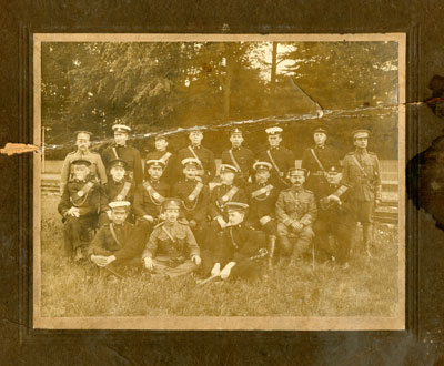 Group photo, 18 soldiers with 3 seated on the grass