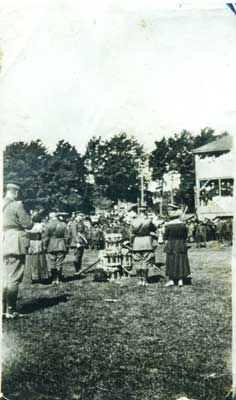 Photograph of 4 soldiers, 2 women and drums