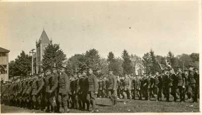4 rows of soldiers standing on a lawn
