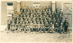 Group Photo Soldiers, 7 rows, standing in front of brick wall