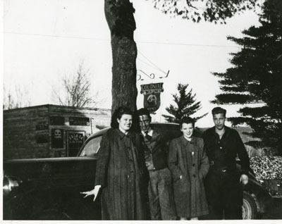 Doris Donnelly, Elmer Donnelly, Joan Charbonneauand Joe Bouillon standing in front of Pat Collin's store