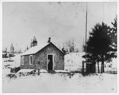The First School House at Bissett Creek