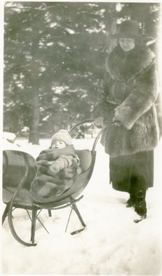 LH1330 Vera Morphy pushing son J. Denys Morphy in a sleigh