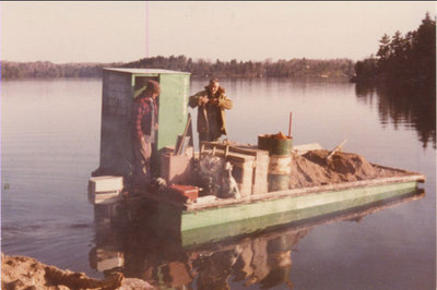 RI0186 - lt to rt - Murray Taylor & George Clifford on scow - Tobin`s Island 1981 - Lake Rosseau
