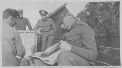 Soldier reading newspaper at Fettercairn