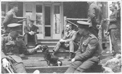 Soldiers playing with dog