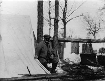 George Bass making maple syrup on his farm c.1925