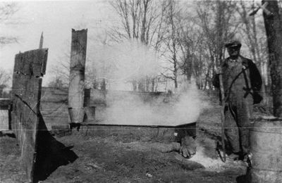 George Bass making maple syrup c.1925
