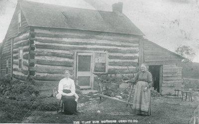 Margaret (Stout) Ferguson and Elizabeth Ferguson in front of Stout cabin.