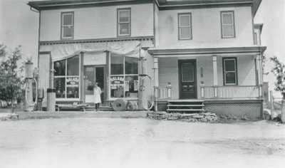 Marion DeWell in front of General Store