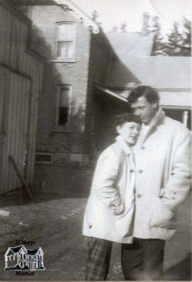 Jack and 'Tiny' Wood in Front of Their House