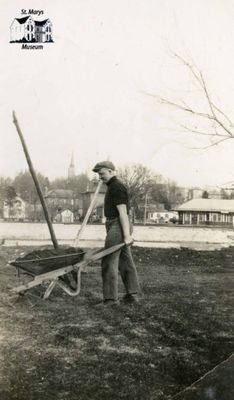 Harvey Ball Jr. Pushing a Wheelbarrow