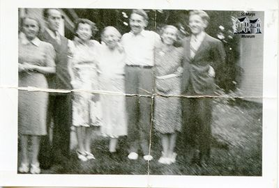 Chesterfield Family Outside Their Family Home