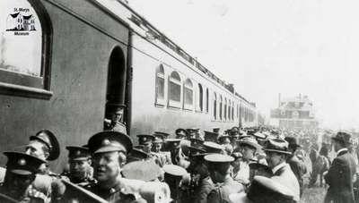 249th Battalion boarding train at station in Regina