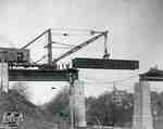 Replacing girders on railway trestle over Trout Creek on London Bridge, 1912