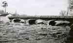 Water rushing under the Victoria bridge, 1947
