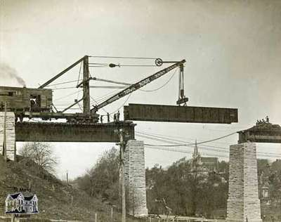 Replacing girders on railway trestle over Trout Creek by CNR station, 1912
