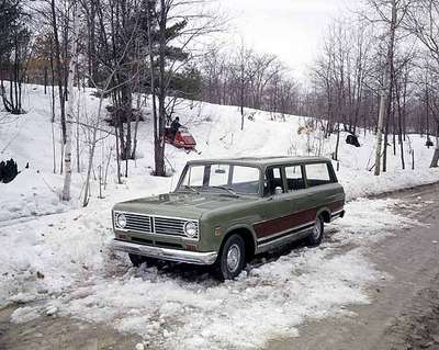 Truck and Snowmobile in the Snow