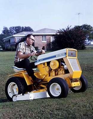 Unidentified Man Mowing a Lawn