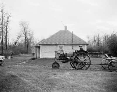 Crank start tractor and wagon, Lawrence Brothers, Melfort, Saskatchewan.
