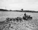 IHC  Crawler Tractor, model TD5 with an IHC, model no. 70, plough.