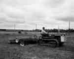 IHC Crawler Tractor, model T5, with disk harrows.