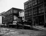Loading/Unloading Crawler Tractors on an Auto Haulaway Truck.