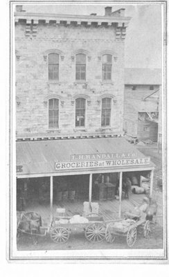 """Exterior view of """"T.H. Randall & Co., Groceries at Wholesale"""", Grand Rapids, Michigan."""
