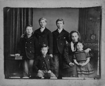 Group portrait of 6 children, 4 boys and 2 girls.