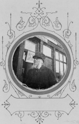 Portrait of an unidentified man with a white beard, taken in front of the Connon Studio, in Elora, Ontario.