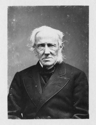 Portrait of an unidentified white haired gentleman, in a dark coat and stock.
