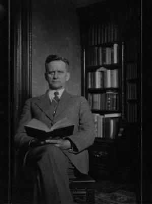 Portrait of an unidentified gentleman, holding an open book.