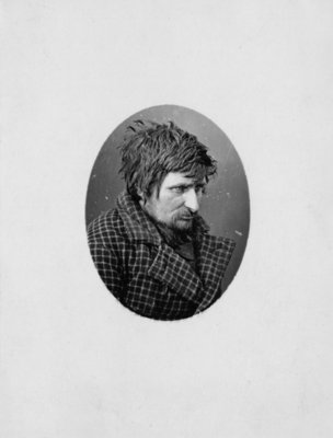 Portrait of an unidentified man in a checked jacket.