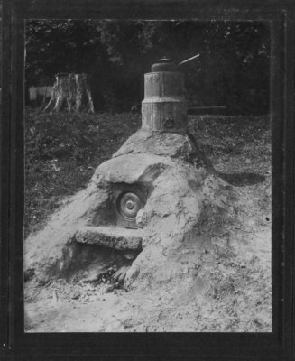 An outdoor structure which may be a clay bake oven.
