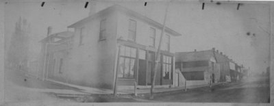 Street view showing storefronts, and buildings, at the corner of Geddes and Moir, Elora.