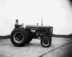 Unidentified Man Sitting on a Tractor