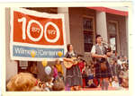 Piper and Gerry Armstrong performing