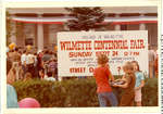 Children standing in front of a sign announcing the Wilmette Centennial Fair on September 24