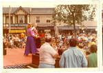 Performers on a stage in the street
