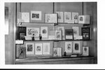 Library display of early editions of Charles Dickens with figurines of the characters
